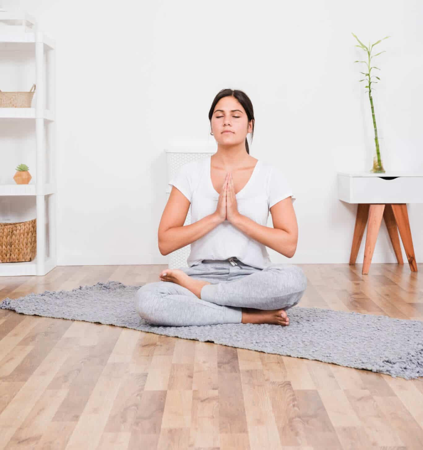 woman at home doing yoga